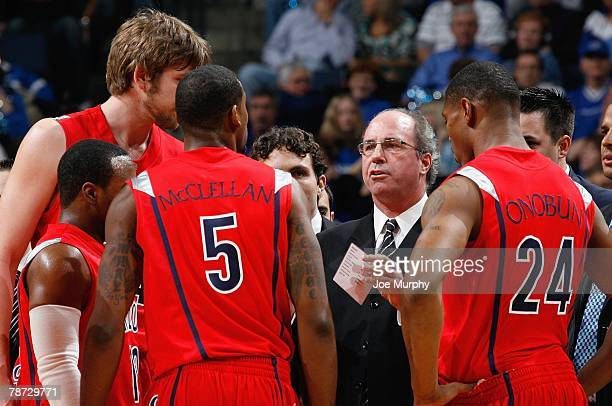 Interim Head Coach Kevin O'Neill of the Arizona Wildcats talks to the players during a timeout in a game against the Memphis Tigers at FedExForum on...
