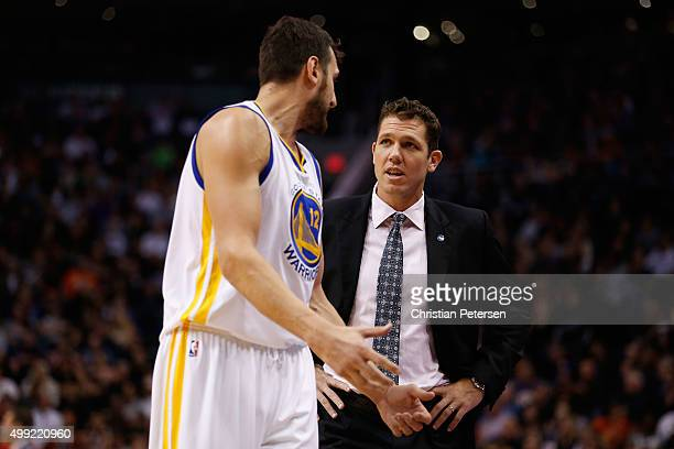 Interim head coach Luke Walton of the Golden State Warriors talks with Andrew Bogut during the NBA game against the Phoenix Suns at Talking Stick...