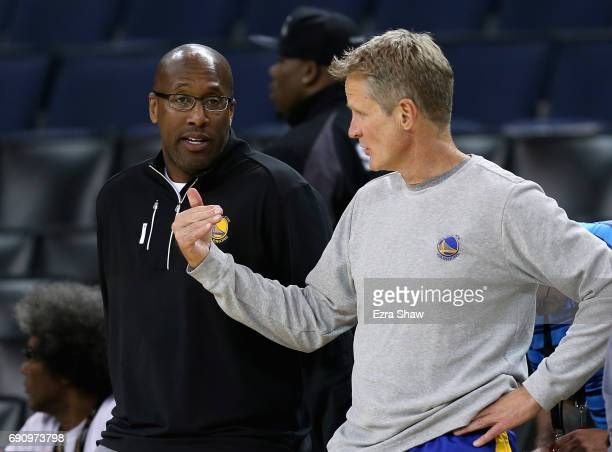 Interim head coach Mike Brown speaks to head coach Steve Kerr of the Golden State Warriors during a practice for the 2017 NBA Finals at ORACLE Arena...