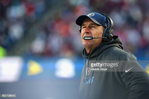 Interim head coach Mike Mularkey of the Tennessee Titans looks on during the first half against the New England Patriots at Gillette Stadium on...