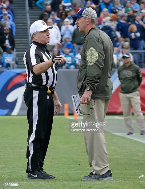 Interim head coach Mike Mularkey speaks to an official during the second half of a game against the Carolina Panthers at Nissan Stadium on November...
