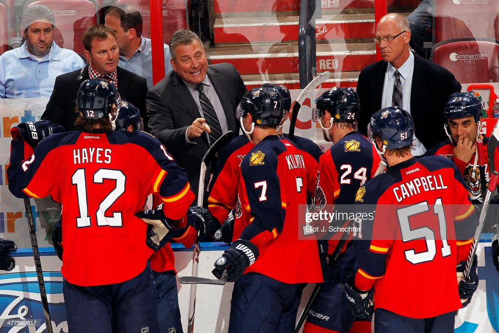 Interim head coach Peter Horachek of the Florida Panthers directs his team from the bench against the Phoenix Coyotes at the BB&T Center on March 11, 2014 in Sunrise, Florida.