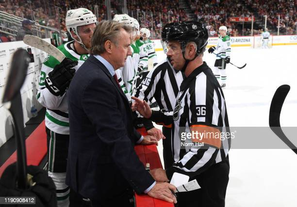 Interim head coach Rick Bowness of the Dallas Stars talks with referee Dean Morton during the first period of the NHL hockey game against the Arizona...