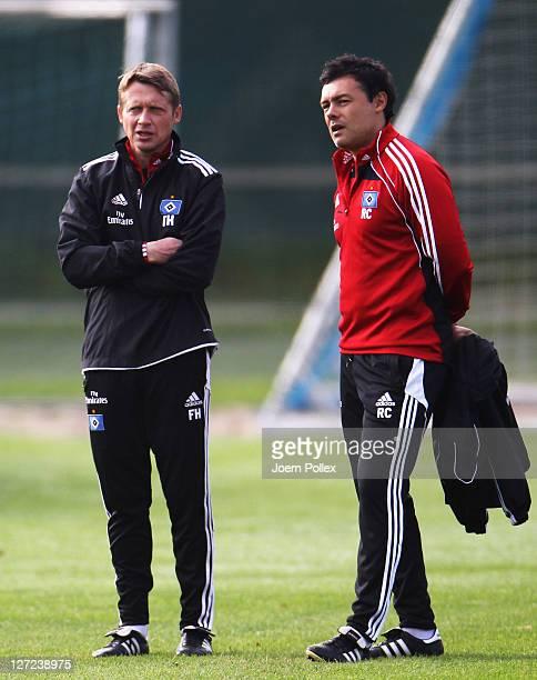 Interim head coach Rodolfo Cardoso and assistent coach Frank Heinemann of Hamburg chat during a Hamburg SV training session on September 27, 2011 in...