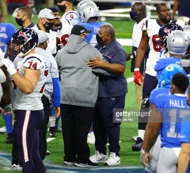 Interim head coach Romeo Crennel of the Houston Texans greets head coach Matt Patricia of the Detroit Lions at midfield following a game at Ford...