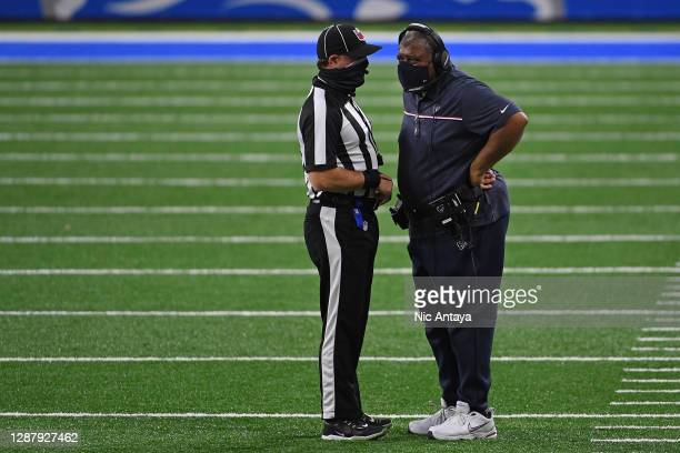 Interim head coach Romeo Crennel of the Houston Texans speaks with an official during the first half against the Detroit Lions at Ford Field on...