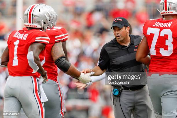 Interim head coach Ryan Day of the Ohio State Buckeyes encourages players in a game between the Oregon State Beavers and the Ohio State Buckeyes on...