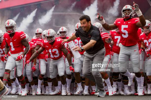 Interim head coach Ryan Day of the Ohio State Buckeyes leads the team out of the player tunnel before a game between the Oregon State Beavers and the...