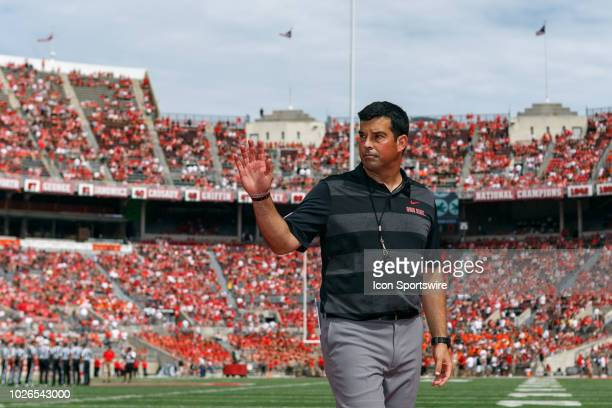 Interim head coach Ryan Day of the Ohio State Buckeyes waves to fans before a game between the Oregon State Beavers and the Ohio State Buckeyes on...