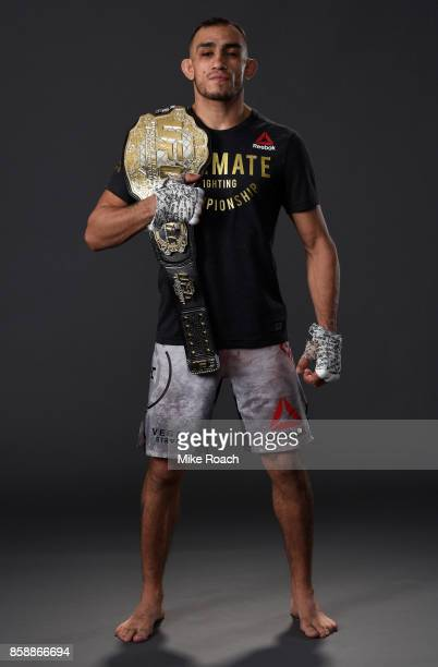 UFC interim lightweight champion Tony Ferguson poses for a portrait backstage after his victory over Kevin Lee during the UFC 216 event inside...