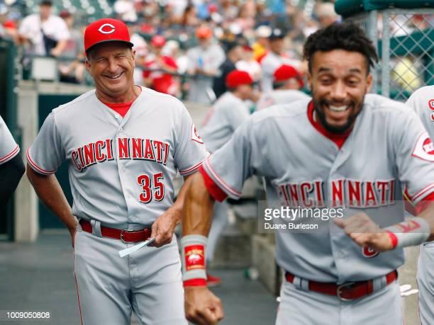 Interim manager Jim Riggleman of the Cincinnati Reds laughs at the antics of Billy Hamilton of the Cincinnati Reds before a game against the Detroit...