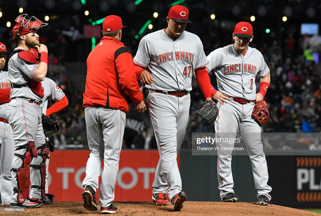 Interim manager Jim Riggleman #35 of the Cincinnati Reds takes the ball from starting pitcher Sal Romano #47 taking Romano out of the game against the San Francisco Giants in the bottom of the third innng at AT&T Park on May 14, 2018 in San Francisco, California.