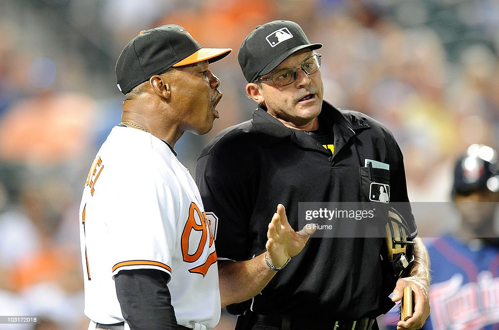 Interim Manager Juan Samuel of the Baltimore Orioles argues with Home plate umpire Bill Hohn during the seventh inning of the game against the Minnesota Twins at the Camden Yards on July 22, 2010 in Baltimore, Maryland.