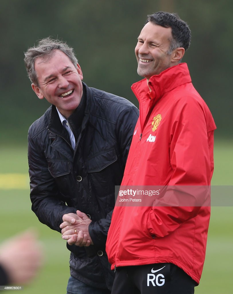 Interim Manager Ryan Giggs and Bryan Robson of Manchester United in action during a first team training session at Aon Training Complex on April 25, 2014 in Manchester, England.