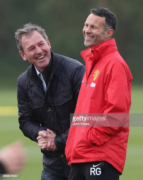 Interim Manager Ryan Giggs and Bryan Robson of Manchester United in action during a first team training session at Aon Training Complex on April 25...
