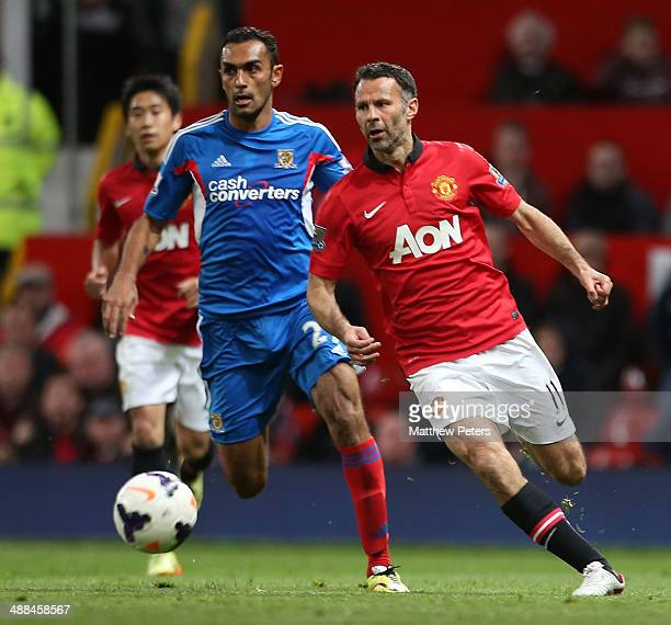 Interim Manager Ryan Giggs of Manchester United in action with Ahmed Elmohamady of Hull City during the Barclays Premier League match between...