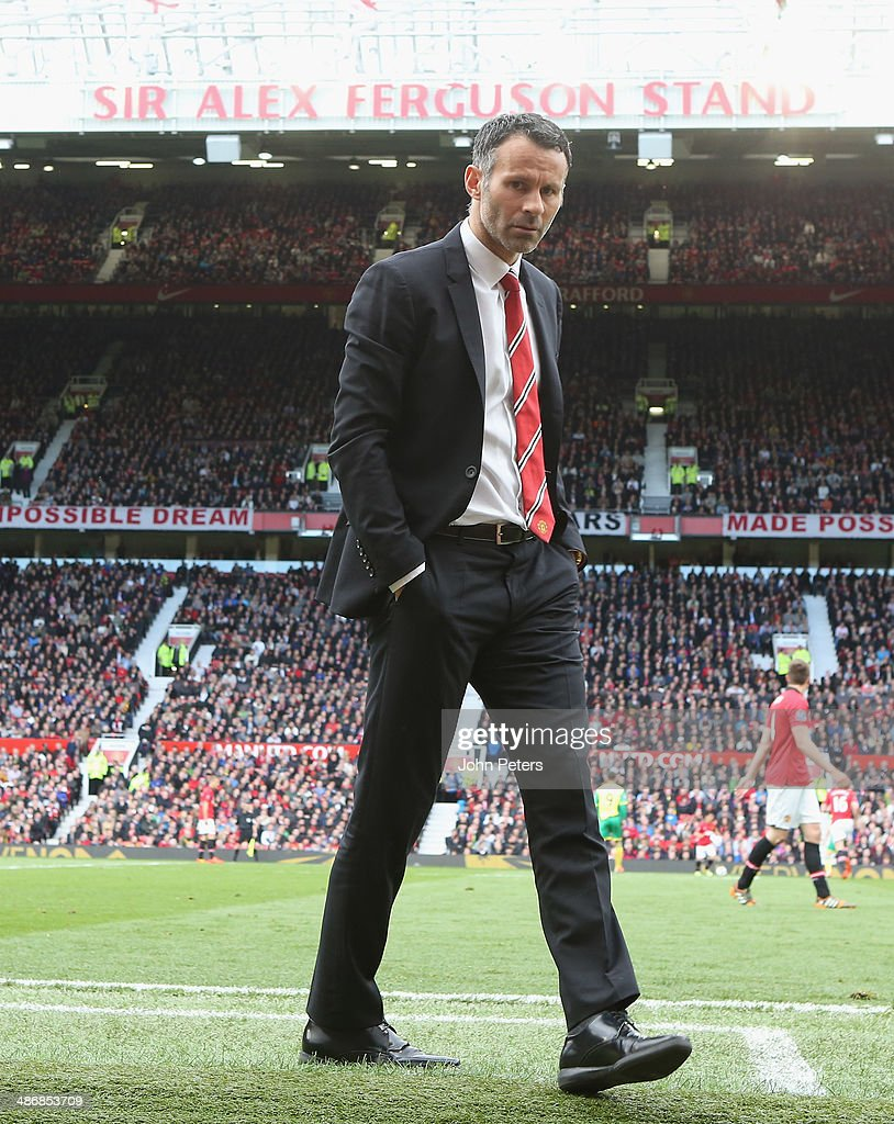 Interim Manager Ryan Giggs of Manchester United watches from the touchline during the Barclays Premier League match between Manchester United and Norwich City at Old Trafford on April 26, 2014 in Manchester, England.