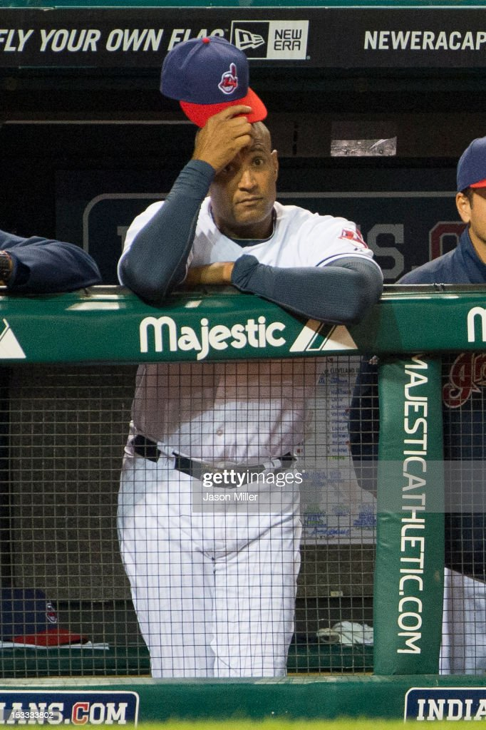 Interim manager Sandy Alomar, Jr. #15 of the Cleveland Indians watches the final out of the season against the Chicago White Sox at Progressive Field on October 3, 2012 in Cleveland, Ohio. The White Sox defeated the Indians 9-0.