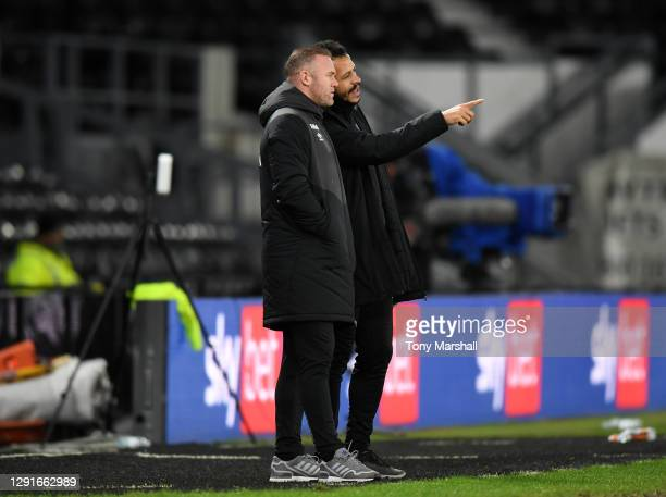 Interim Manager Wayne Rooney of Derby County and coach Liam Rosenior of Derby County during the Sky Bet Championship match between Derby County and...