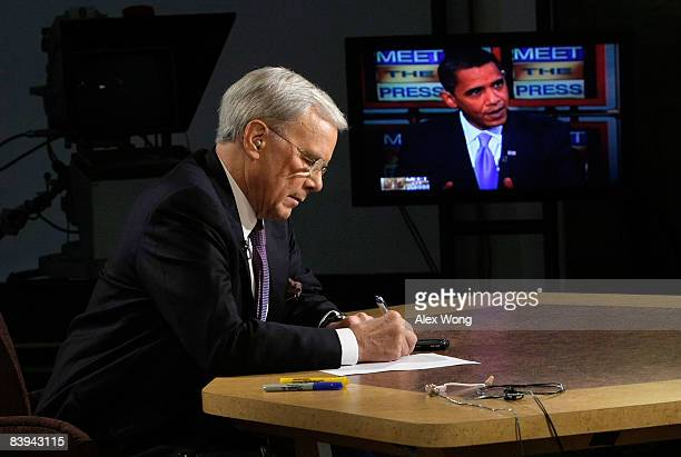 Interim moderator of 'Meet the Press' Tom Brokaw takes notes as his interview with Presidentelect Barack Obama is played on a monitor at the NBC...