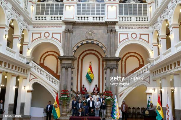 Interim president Jeanine Añez and other government members during a press conference to approve the bill to call for fresh elections at Bolivian...