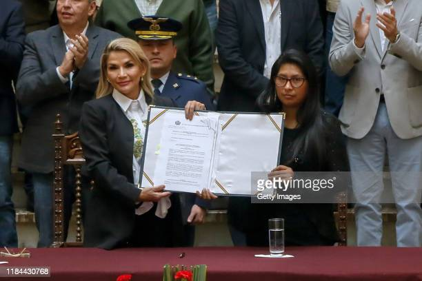 Interim president Jeanine Añez shows the new elections bill with Monica Eva Copa during a press conference to approve the bill to call for fresh...