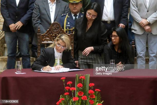 Interim president Jeanine Añez signs the new elections bill during a press conference to approve the bill to call for fresh elections at Bolivian...