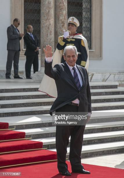 Interim president Mohamed Ennaceur greets newly-elected Tunisian President Kais Saied during the ceremony of transfer of power at the Palace of...
