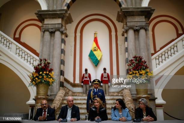 Interim President Of Bolivia Jeanine Añez speaks during a press conference at presidential palace next to Minister of Health Anibal Cruz Minister of...