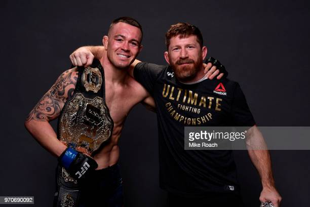 UFC interim welterweight champion Colby Covington poses with coach Mike Brown for a post fight portrait backstage during the UFC 225 event at the...