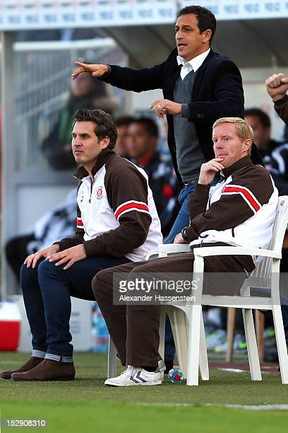 Interimscoaches Thomas Meggle and Timo Schultz reacts with team manager Rachid Azzouzi during the Second Bundesliga match between Jahn Regensburg and...