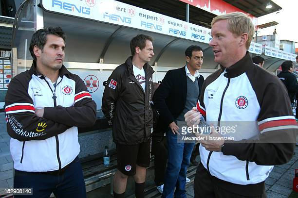 Interimscoaches Thomas Meggle of St. Pauli looks on with Timo Schultz prior the Second Bundesliga match between Jahn Regensburg and FC St. Pauli at...