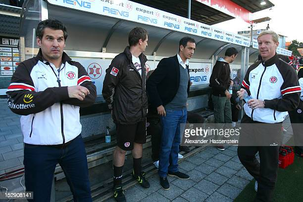 Interimscoaches Thomas Meggle of St Pauli looks on with Timo Schultz prior the Second Bundesliga match between Jahn Regensburg and FC St Pauli at...