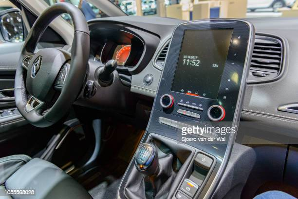Interio of a Renault Scenic or Renault Scénic compact MPV fitted with leather seats and an information display on the dachboard on display at...