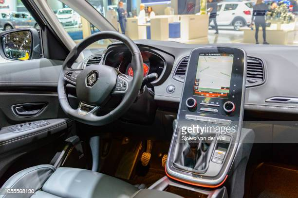 Interio of a Renault Scenic or Renault Scénic compact MPV fitted with leather seats and a navigation information display on the dachboard on display...