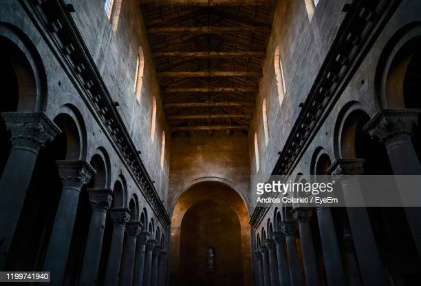 interior ancient medieval church cathedral with columns - cathedral stock pictures, royalty-free photos & images