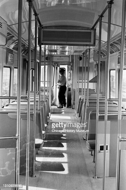 Interior and exterior views of new elevated train cars at Skokie Yards, 3701 Oakton Street, Skokie, Illinois, May 26, 1964.