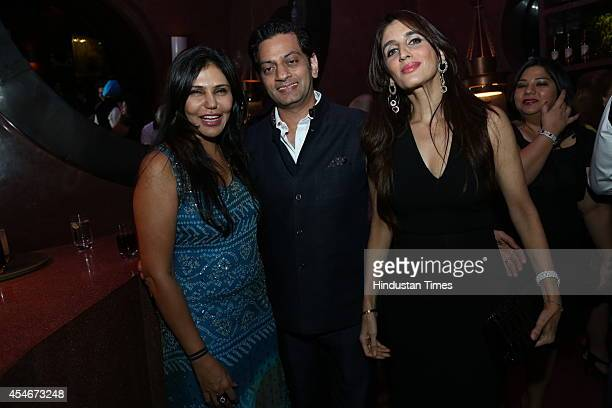 Interior architect Nisha Jamwal with fashion designer Raghvendra Rathore and gemologist Farah Khan Ali during a champagne brunch to celebrate the...