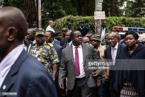 Interior Cabinet Secretary Fred Matiang'i walks towards members of the media during a press conference outside of the Dusit Hotel on January 16 2018...