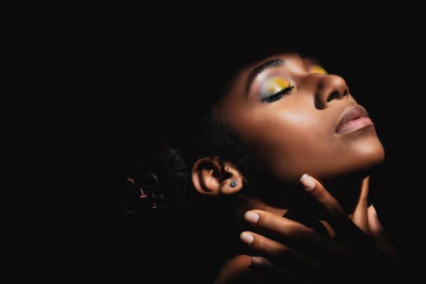 Interior chiaroscuro portrait of young black woman