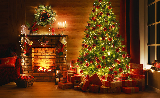 interior christmas. magic glowing tree, fireplace, gifts in  dark 1187452672