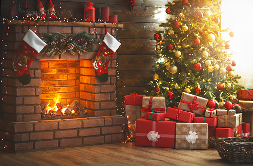 interior christmas. magic glowing tree, fireplace, gifts 873180722