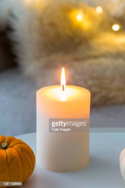 interior decor celebrating autumn with candle - candle stock pictures, royalty-free photos & images