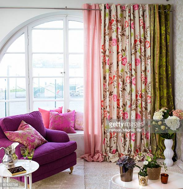 Interior decoration with textiles and an armchair, Sweden.