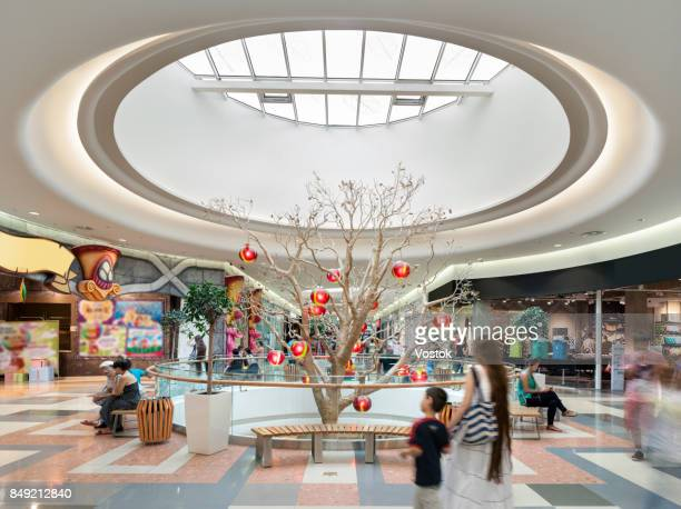 interior design and decor in a large shopping mall in almaty - shopping centre stock photos and pictures