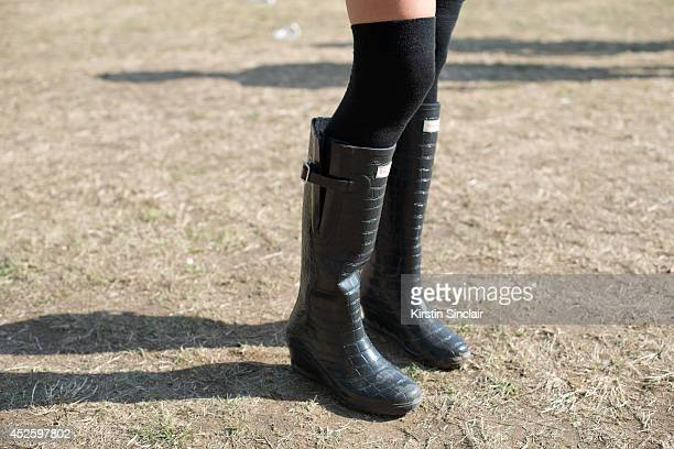 Interior Design Director Tace Traviss wearing Wedge boots at Lovebox 2014 on July 19 2014 in London England