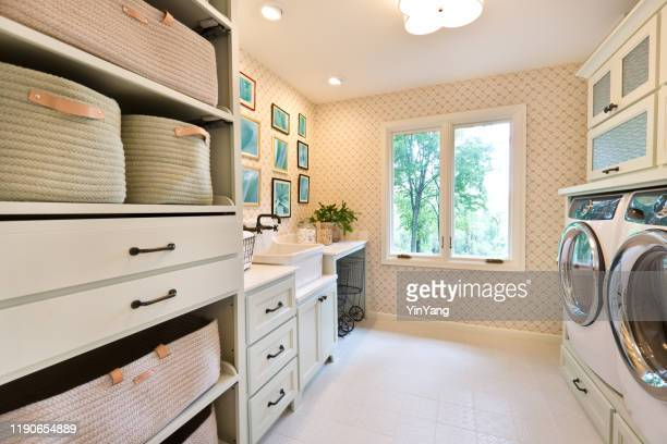 interior design laundry utility room of residential home - storage compartment stock pictures, royalty-free photos & images