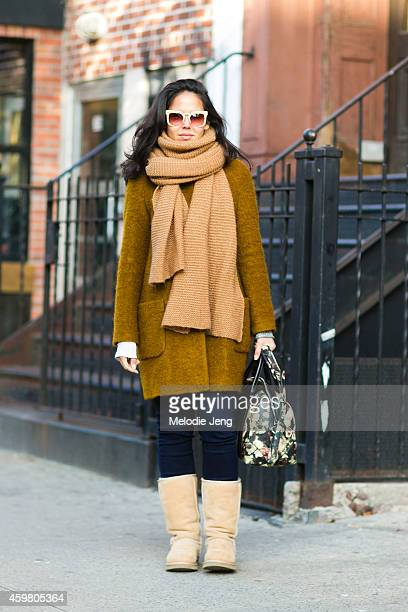 Interior Designer Manuela Giannini wears Zara Helmut Lang a Givenchy bag and Grey Ant sunglasses on the Bowery on November 23 2014 in New York City