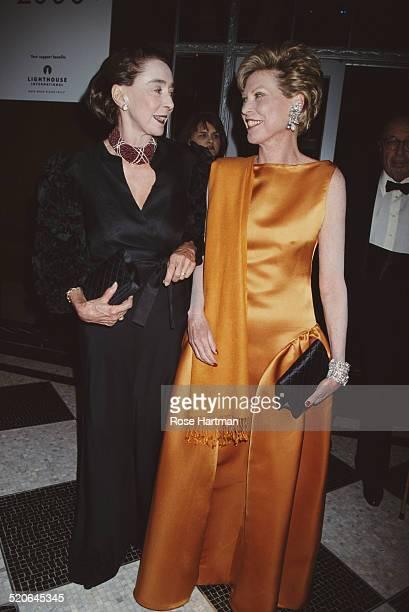 Interior designer Mica Ertegün and Vogue editor and Manhattan socialite Louise Melhado attend a Spanish gala at the Plaza Hotel New York City USA 1990