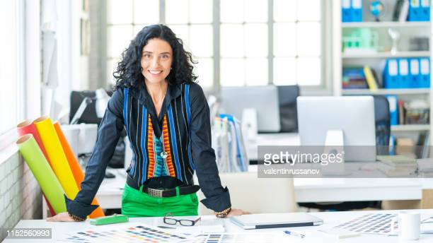 interior designer working on home design at a office - interior design foto e immagini stock